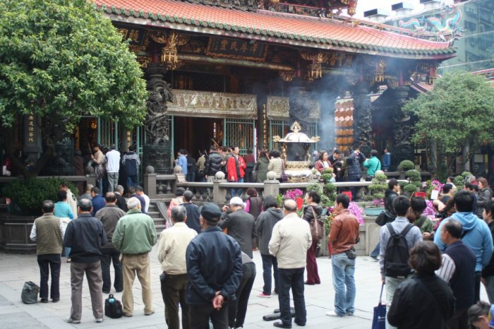People come to the temple to pray and celebrate the new year.