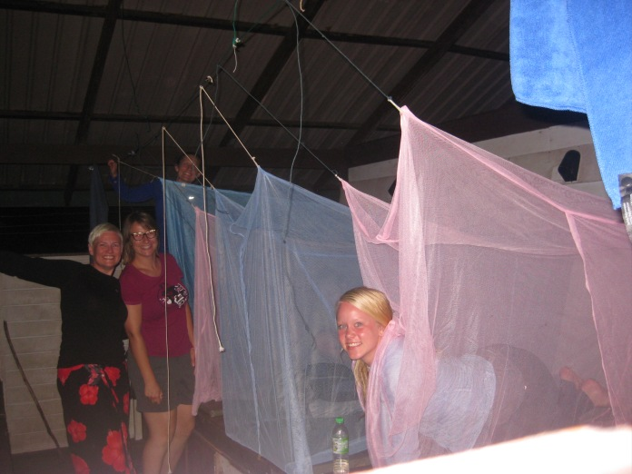 Happy in dry clothes and mosquito nets