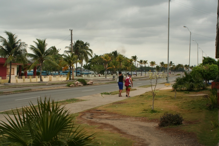 Walking along the Malecon towards Cienfuegos' city center