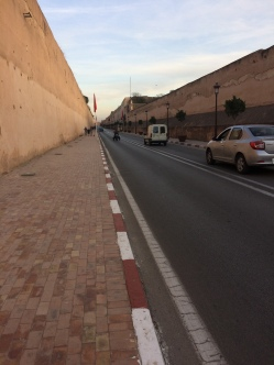 The road between the tall walls of the royal palace