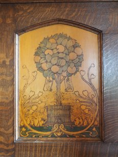 A wood carving in a cabinet.
